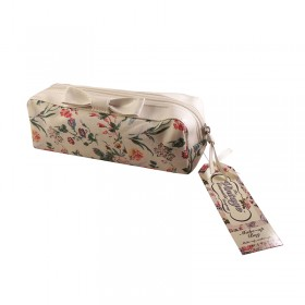 white_flowery_make_up_bag_angled